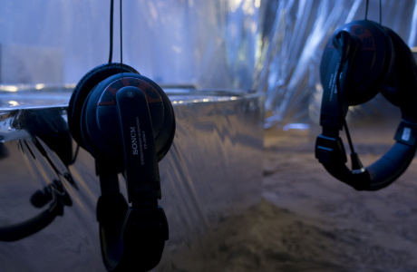 Headphones hanging from the tree inside the installation